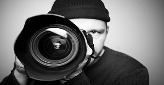 Private detective uses long range camera to perform surveillance.